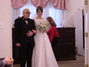 My father walking me down the aisle, his hair growing back after the latest round of chemo.  Thank you for living to see my wedding, daddy, it meant the world to me.