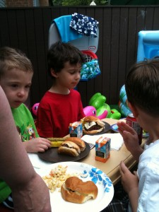 Tyler and his friends, at the little table, enjoying the EATS!