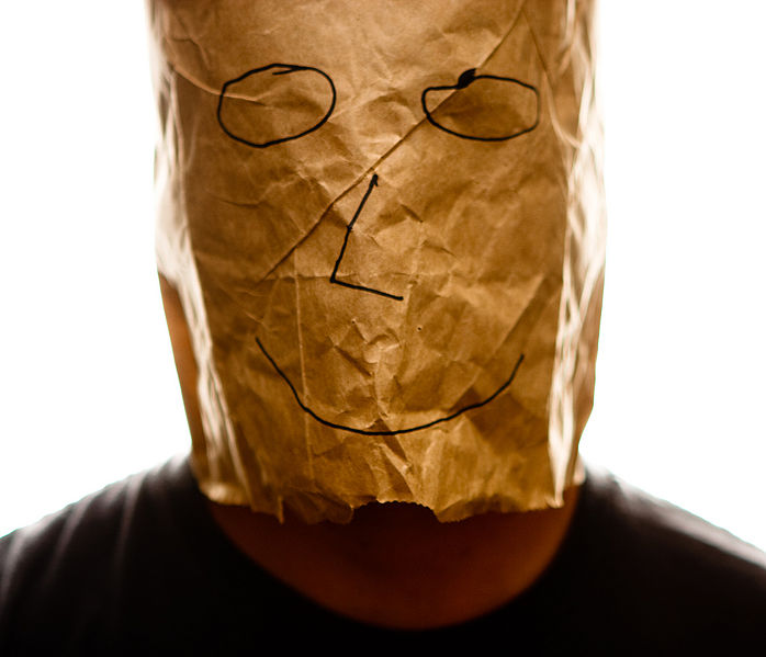 698px-Brown_paper_bag_with_happy_smiley_over_head
